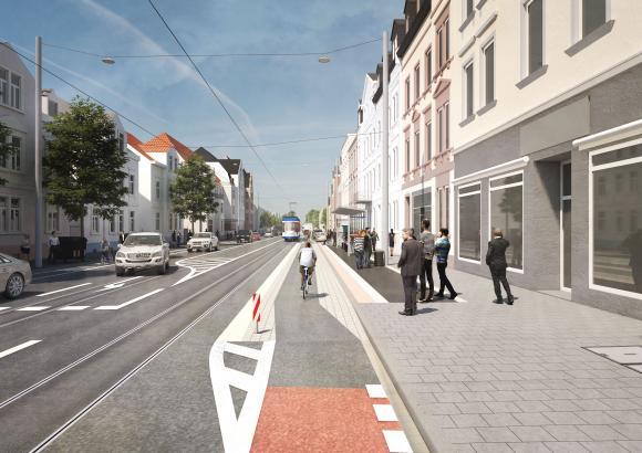 Fahrradfahrer werden vor der Haltestelle entlang geführt.